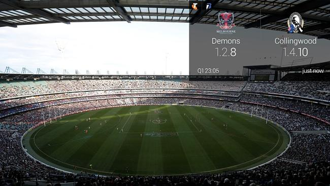 Telstra Google Glass AFL app demonstration during the 2013 AFL Round 11 match between the Melbourne Demons and the Collingwood Magpies at the MCG. Photo: Darrian Traynor/AFL Media