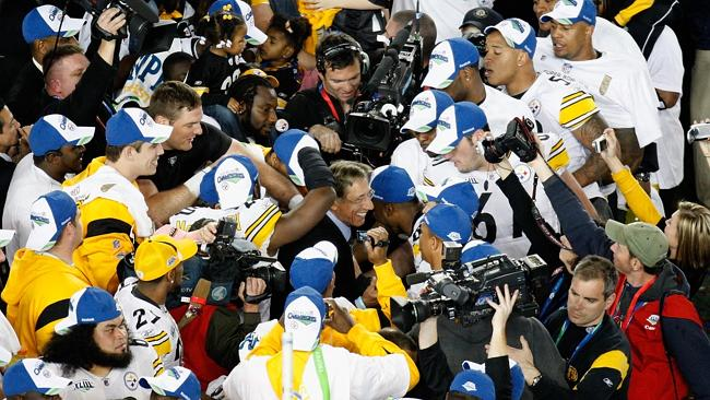 American football great ... The Pittsburgh Steelers mob Joe Namath as he carries in the Vince Lombardi trophy after the Steelers won 27-23 against the Arizona Cardinals during Super Bowl XLIII on February 1, 2009. Picture: Doug Benc/Getty Images/AFP