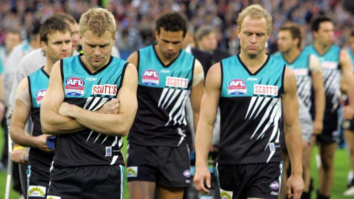 Footballer Kane Cornes with Chad Cornes after loss. AFL football - Geelong vs Port Adelaide Power Grand Final match at MCG 29 Sep 2007. /Football/AFL