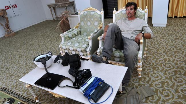 On the job ... This file picture taken September 29, 2011 shows US freelance reporter James Foley resting in a room at the airport of Sirte, Libya. Source: AFP