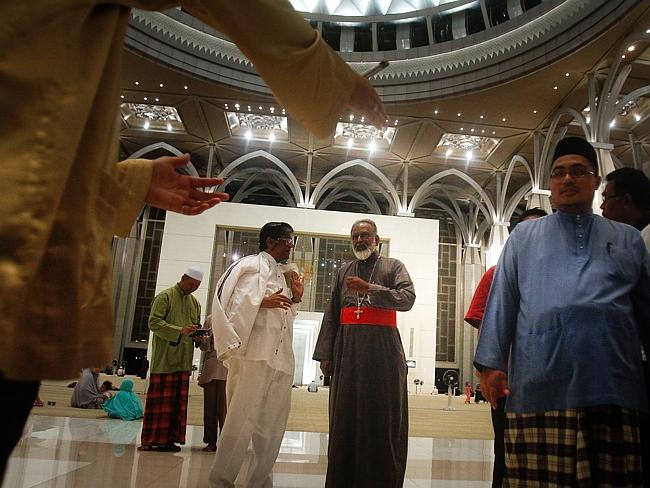 Prayers ... Christians, Hindus, Buddhists and Muslims attend a special prayers held in Sultan Mizan Zainal Abidin mosque for the missing Malaysian airliner MH370.