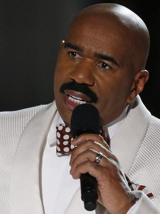 He will be back ... Steve Harvey holds up the card showing the winners after he incorrectly announced Miss Colombia Ariadna Gutierrez at the winner at the Miss Universe pageant. Picture: AP