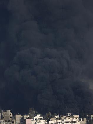 Strike ... thick black smoke rises over Gaza City. Picture: Hatem Moussa
