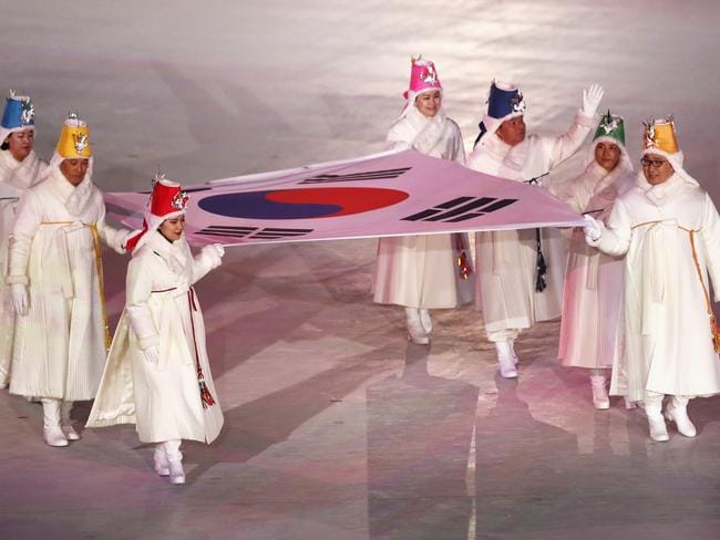 The South Korean flag is carried into the stadium by former athletes. Picture: Ronald Martinez/Getty Images