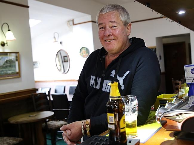 Sad memories ... Nic Clayton, 54, a former mechanical engineer at Anglesey Aluminium in Holyhead having a cider at the Prince of Wales pub. Picture: Ella Pellegrini