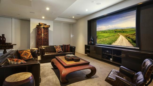 84/7 Riverside Quay, Southbank. If you ever get sick of looking at the 360 degree views, the home theatre has you covered