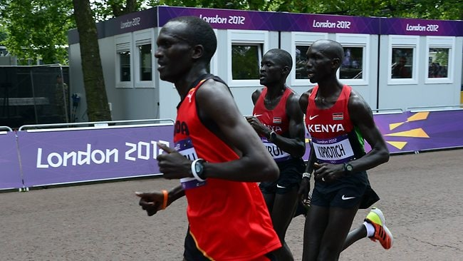 Uganda's Stephen Kiprotich (front), Kenya's Abel Kirui (back left)) and Wilson Kipsang Kiprotich (back right) run the final lap in the men's marathon.