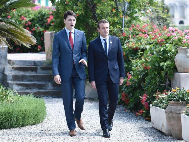 As this picture of Canadian Prime Minister Justin Trudeau and French President Emmanuel Macron shows, centrists are annoying but good at winning elections. Picture: Stephane De Sakutin