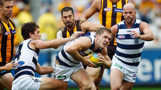 Geelong captain Joel Selwood bursts out of trouble to set up a late goal for the Cats. Picture: Klein Michael