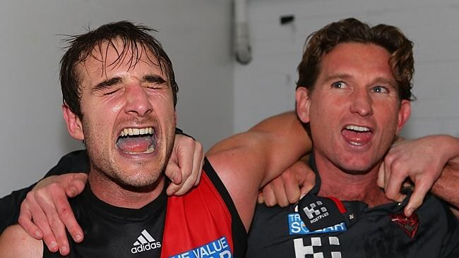 June 27, 2013: Jobe Watson and James Hird sing the club song after a stirring win over West Coast at Patersons Stadium. Picture: Paul Kane/Getty