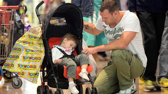 Paul Lagwa Christmas shopping at Chadstone with son, who just couldn't keep up with the pace.