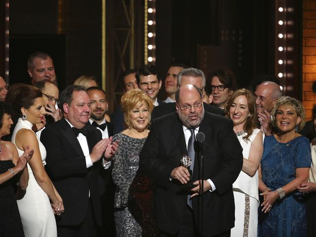 "Scott Rudin, centre, and the cast of ""Hello, Dolly!"" accept the award for best revival of a musical at the 71st annual Tony Awards. Picture: AP"