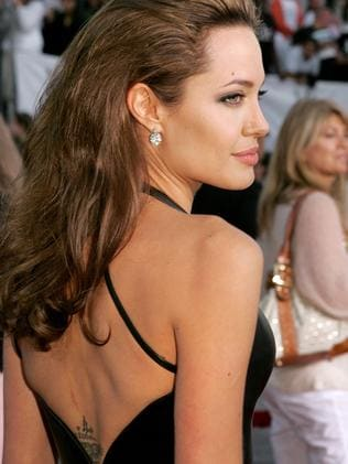 Angelina Jolie in 2005, with a relatively tattoo-free back. Picture: Kevin Winter/Getty Images