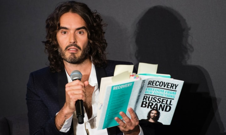 Russell Brand chokes up as he recounts his daughter's birth