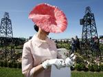 2015 Melbourne Cup Day at Flemington Racecourse. Myer Fashion in the Field. Angela McCormick wearing a Julie Casey hat checks her phone while in line for judging. Picture: David Caird.