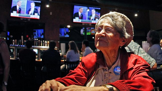 Sophie Bock, a supporter of Barack Obama, watches a televised debate between Republican presidential candidate Mitt Romney and the president. Picture: AP /Alan Diaz