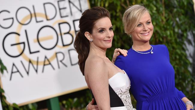 Tina Fey, left, and Amy Poehler in their first outfits of the night.