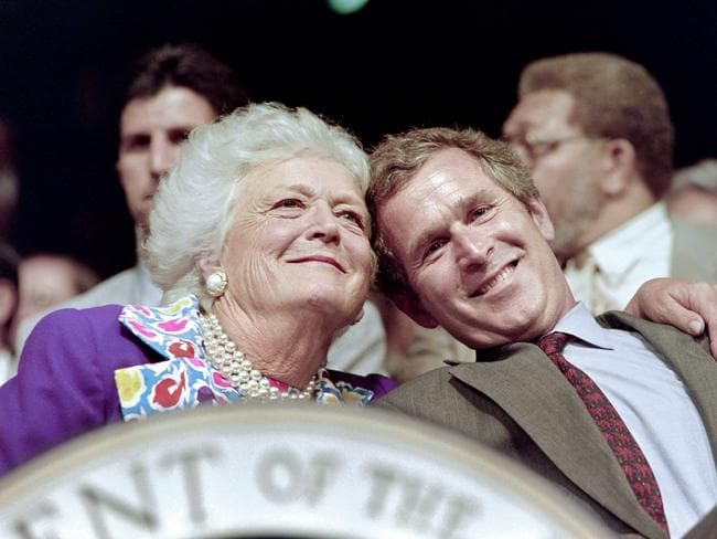 Mrs Bush, pictured with her son George W. Bush in 1992, is one of only two first ladies who was also the mother of a president. Picture: AFP Photo/Chris Wilkins