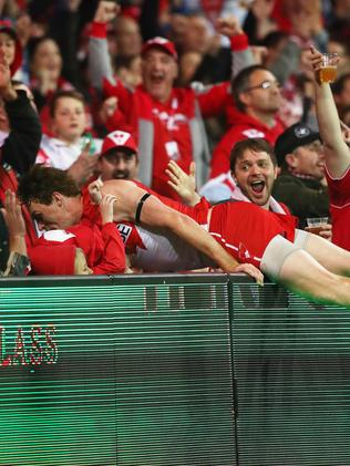 Rohan's momentum carries him over the fence at the SCG. Picture: Phil Hillyard