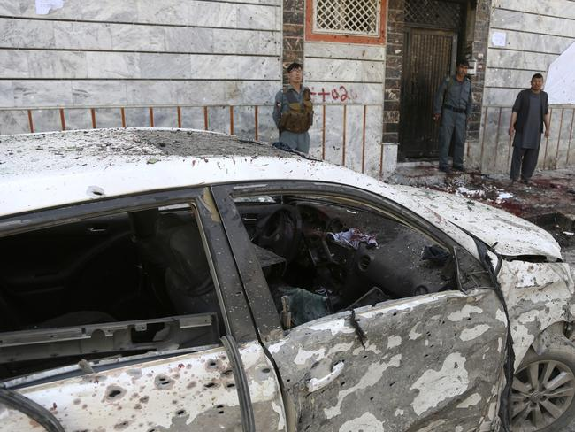 Afghan police stand outside a voter registration centre which was attacked by a suicide bomber in Kabul, Afghanistan, Sunday, April 22, 2018. Picture: AP