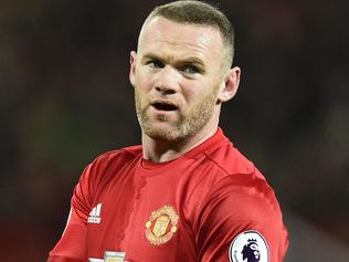 Manchester United's English striker Wayne Rooney is pictured during the English Premier League football match between Manchester United and Liverpool at Old Trafford in Manchester, north west England, on January 15, 2017. / AFP PHOTO / Oli SCARFF / RESTRICTED TO EDITORIAL USE. No use with unauthorized audio, video, data, fixture lists, club/league logos or 'live' services. Online in-match use limited to 75 images, no video emulation. No use in betting, games or single club/league/player publications. /
