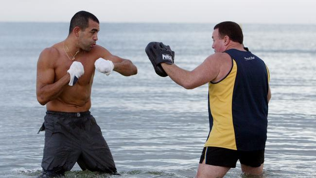 Boxer Sam Soliman training on St Kilda beach with Dave Hedgecock.