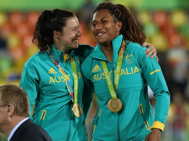 Emilee Cherry and Ellia Green celebrate winning gold. Picture: Adam Head