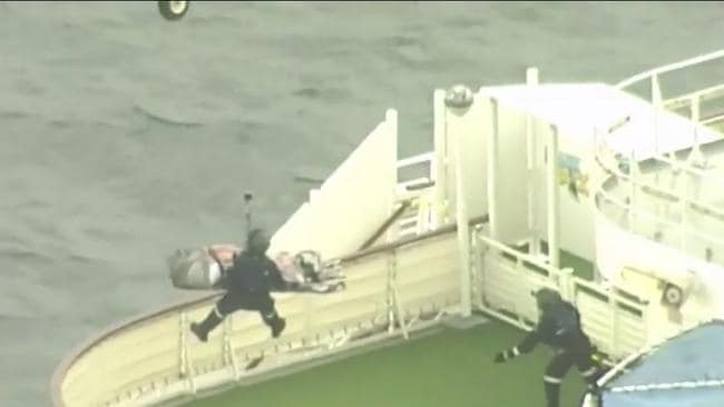 The woman was winched off the ship and flown to hospital. Picture: Nine News Queensland