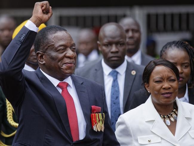 Emmerson Mnangagwa, centre, and his wife Auxillia, right, arrive at the presidential inauguration ceremony. Picture: AP