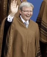 Australia's Prime Minister Kevin Rudd seems to be enjoying himself as he wears a traditional Peruvian poncho during the official group photo of the 16th summit of the Asian Pacific Economic Cooperation.