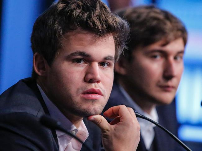 Magnus Carlsen of Norway sits next to Russian chess grand master Sergey Karjakin ahead of their final showdown in New York. Picture: Kena Betancur