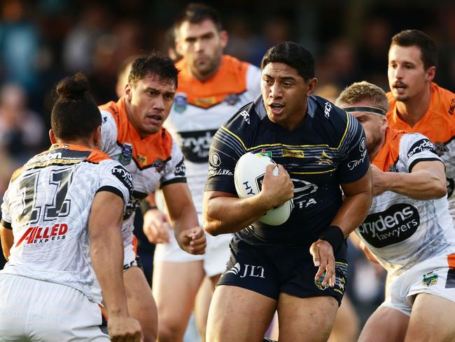 Jason Taumalolo takes on the defence to be surrounded by Tigers players.