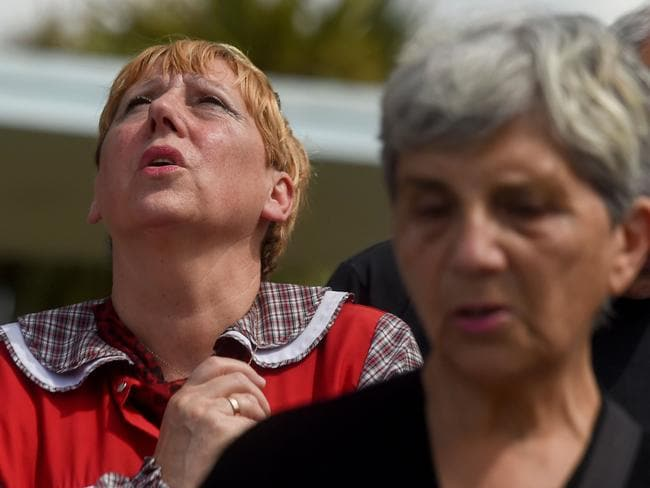 People pray outside Argentina's Navy base in Mar del Plata, on the Atlantic coast south of Buenos Aires. Picture: AFP