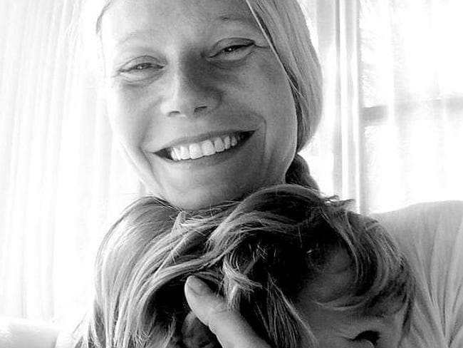 Gwyneth Paltrow tweeted a picture of herself hugging her son while still wearing her wedding band after announcing her separation.