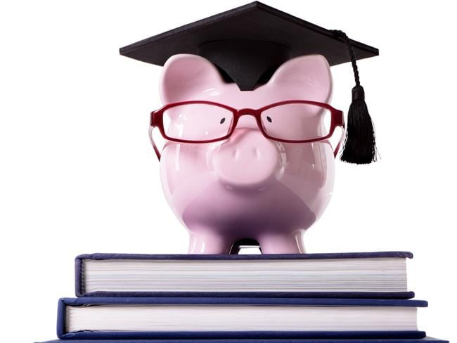YOUR MONEY  ..  Graduate Piggy Bank / lessons in finance