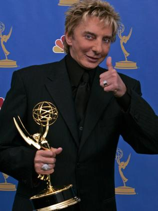 Barry Manilow holds the award for outstanding individual performance in a variety or music program for his work on the TV show 'Barry Manilow: Music and Passion', at the 58th Annual Primetime Emmy Awards in 2006. Picture: Supplied