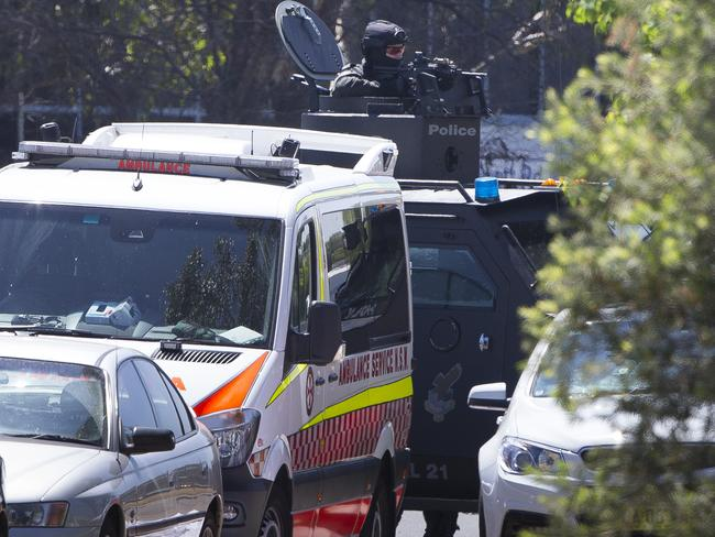 Armed officer inside the BearCat at the scene. Picture: Melvyn Knipe