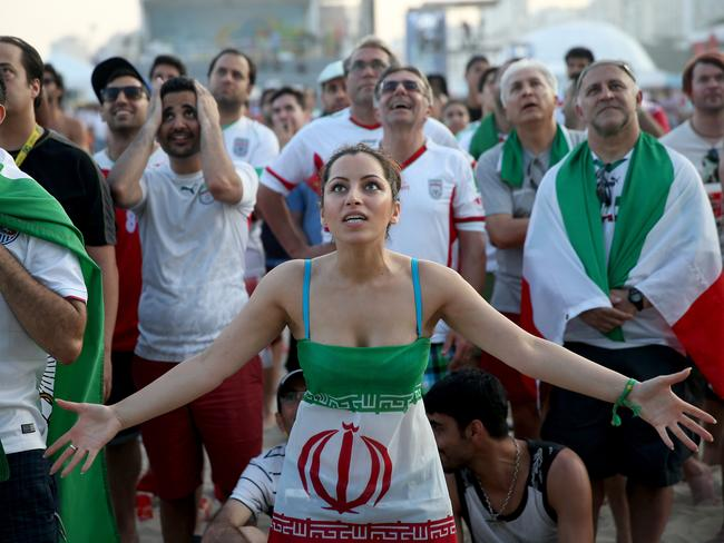Iranian fans react as their team plays against Nigeria.