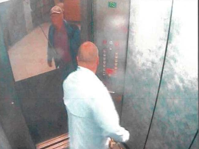 7.32am: McNamara and Rogerson use the lift at the apartment, carrying fishing rods which have been taken out of the boat.