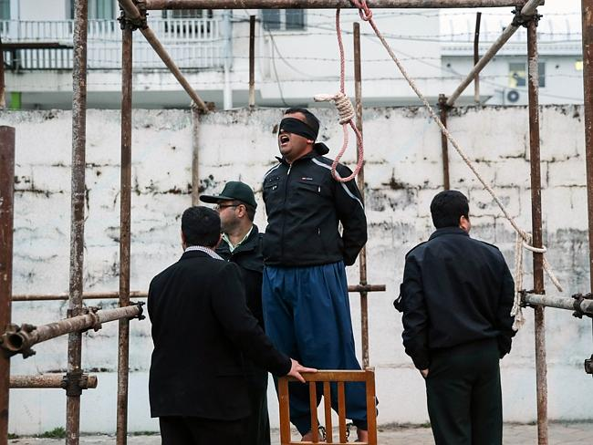 Gallows ... Murderer Balal sands before the noose during his public execution ceremony in Nowshahr, Iran. Picture: AFP/ARASH KHAMOOSHI/ISNA