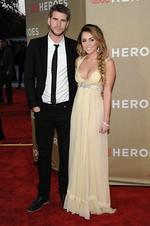 <p>Actor Liam Hemsworth (left) and actress and singer Miley Cyrus arrive at the Fifth Annual CNN Heroes: All-Star Tribute in Los Angeles on Sunday, Dec. 11, 2011. (AP Photo/Dan Steinberg)</p>