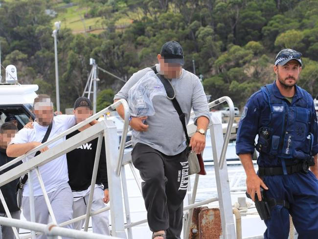 Passengers from the Carnival Legend being taken off the cruise ship by police in an unscheduled stop in Eden, NSW.