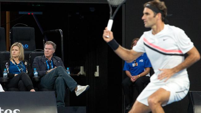 Will Ferrell watches Roger Federer from his courtside seats at Rod Laver Arena.