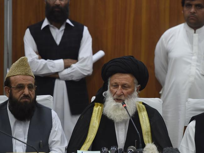 Council of Islamic Ideology chairman Maulana Muhammad Khan Sherani (right) addresses a press conference in Islamabad. Picture: AFP/Farooq Naeem