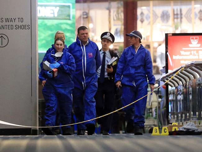 Forensic services work on the crime scene at Westfield Parramatta. Picture Craig Greenhill