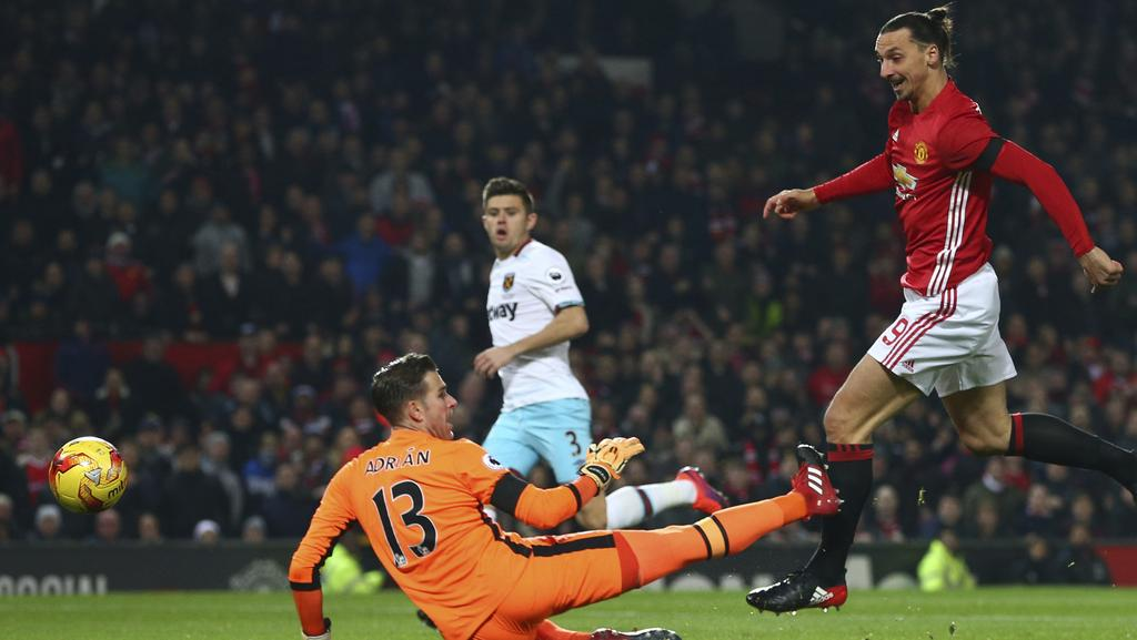 Manchester United's Zlatan Ibrahimovic, right, shoots and scores.