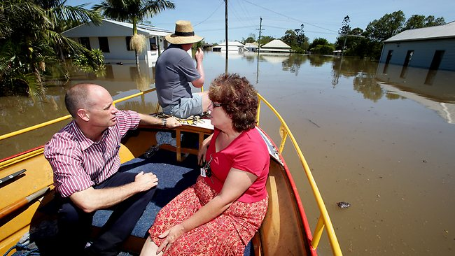 PREMIER Campbell Newman with Water St, Bundaberg, resident Jill Hall, whose house has been inundated. PIC: Mark Calleja