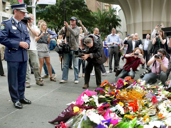 Police Commissioner Andrew Scipione at the Martin Place flower memorial.