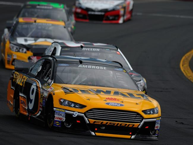 Marcos Ambrose drives his #9 DeWalt Ford during a NASCAR Sprint Cup Series race.