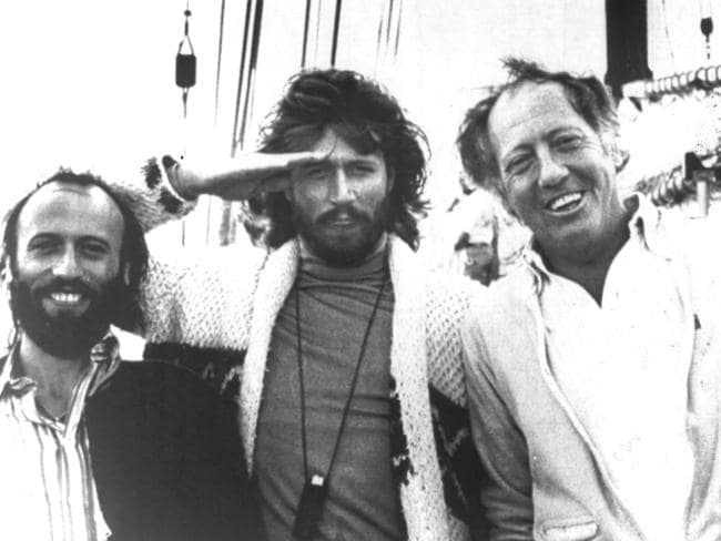 Robert Stigwood (right) with Bee Gees Maurice (left) and Barry Gibb aboard Stigwood's yacht, 1978.
